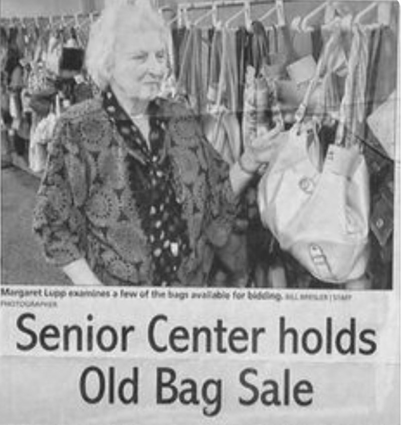 History - Margaret Lupp exines a lew of the bags available for bidng Senior Center holds Old Bag Sale