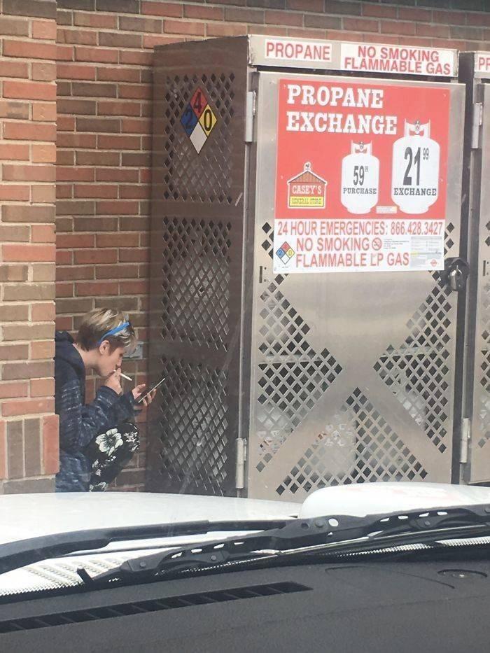 Automotive exterior - PROPANE NO SMOKING FLAMMABLE GAS PF PROPANE EXCHANGE 21 59 EXCHANGE CASEY'S PURCHASE 24 HOUR EMERGENCIES: 866.428.3427 NO SMOKING FLAMMABLE LP GAS