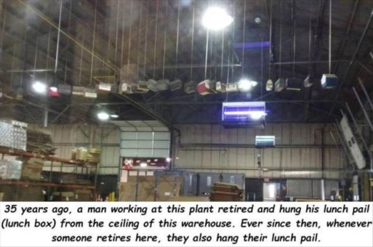 work meme - Lighting - 35 years ago, a man working at this plant retired and hung his lunch pail (lunch box) from the ceiling of this warehouse. Ever since then, whenever someone retires here, they also hang their lunch pail.