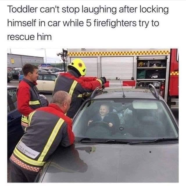 pic of a baby laughing inside a car while firefighters surround it trying to free him