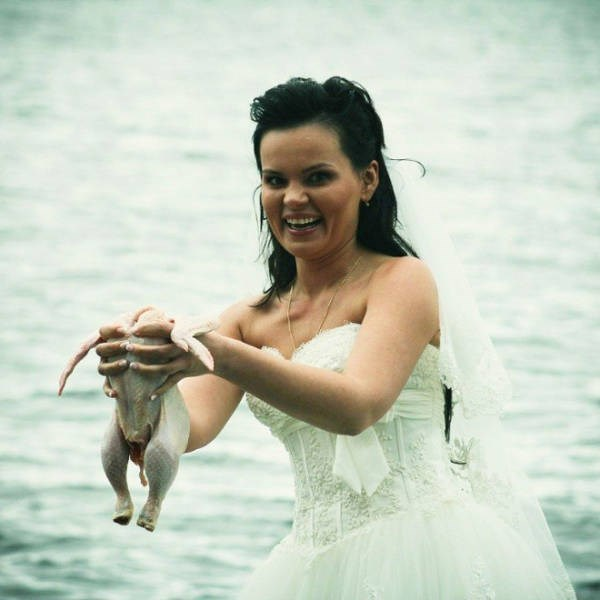 Bride holding headless raw chicken