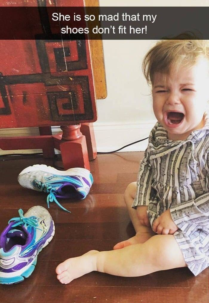 kid tantrums - Child - She is so mad that my shoes don't fit her!