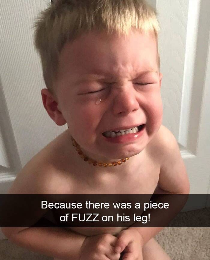 kid tantrums - Face - Because there was a piece of FUZZ on his leg!