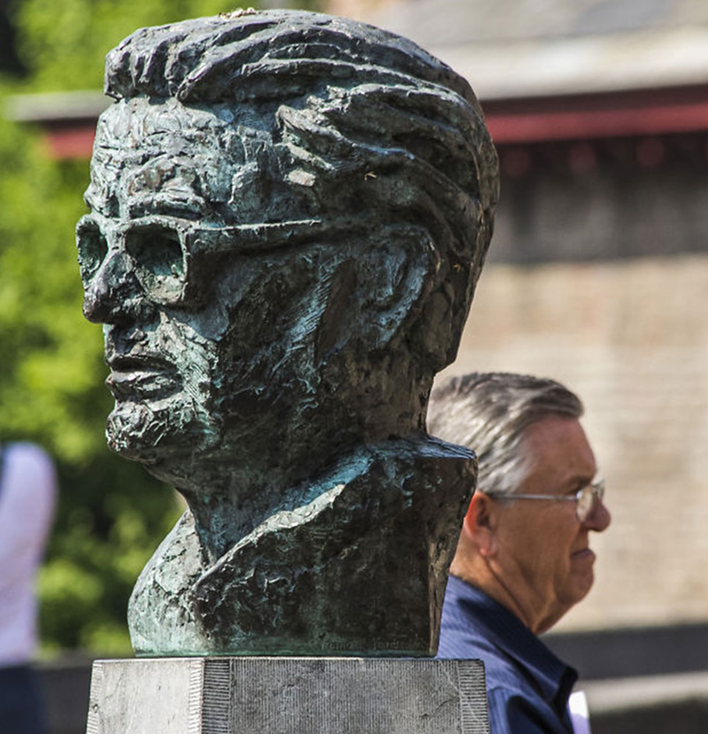 man's face looks similar to statue