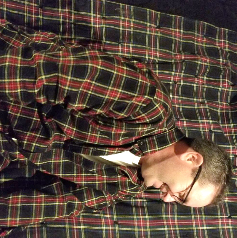 man's plaid shirt matches blanket