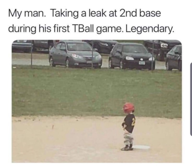 Photo caption - My man. Taking a leak at 2nd base during his first TBall game. Legendary