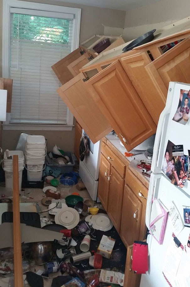 disaster of cabinets fallling off the wall and all the dishes crashing down onto the floor