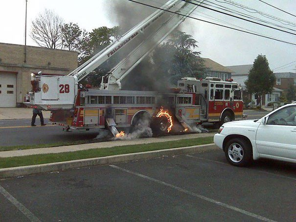 Funny photo of a fire truck catching on fire