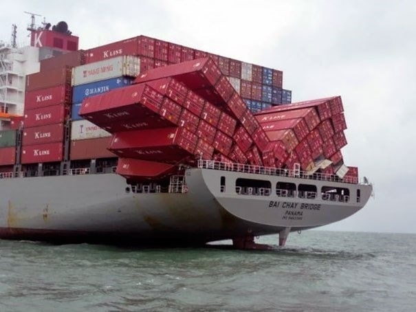 Funny photo of cargo falling off of a cargo ship
