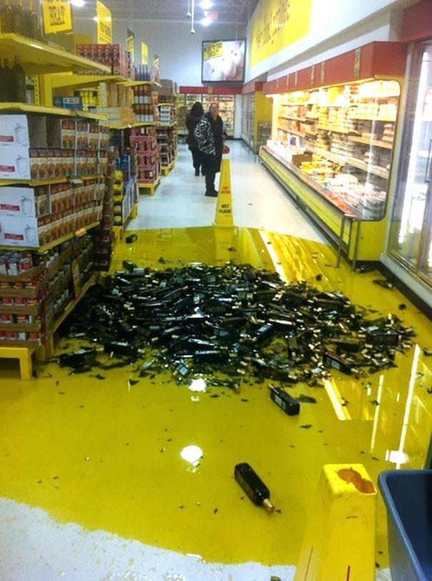 bunch of olive oil that spilled off the shelf in the super market