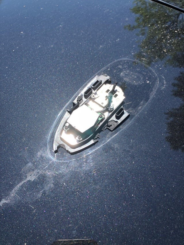 optical illusion car parts that looks like a sinking boat
