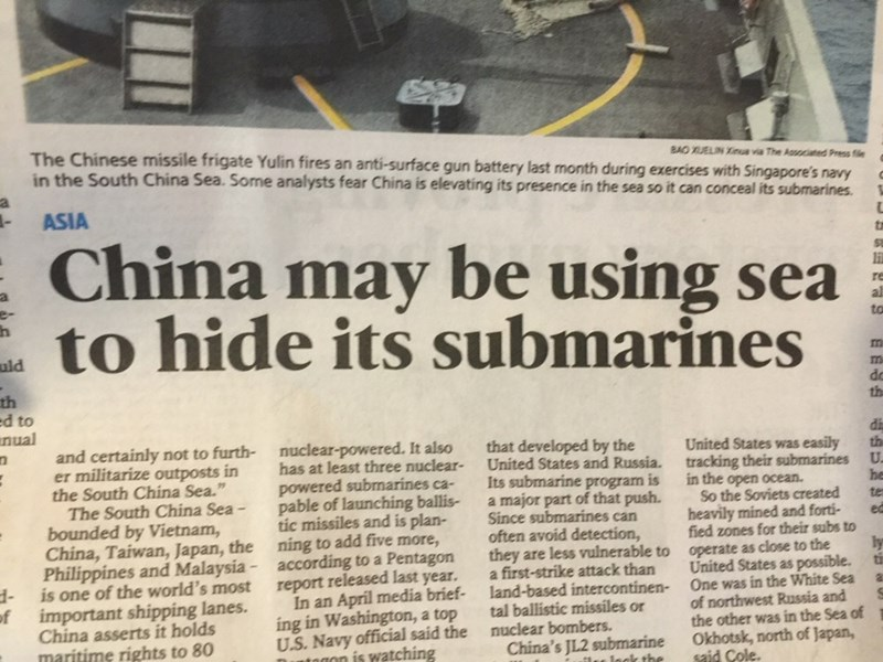news headlines - Text - BAO UELIN Xinua via The Aosociated Press fle The Chinese missile frigate Yulin fires an anti-surface gun battery last month during exercises with Singapore's navy in the South China Sea. Some analysts fear China is elevating its presence in the sea so it can conceal its submarines