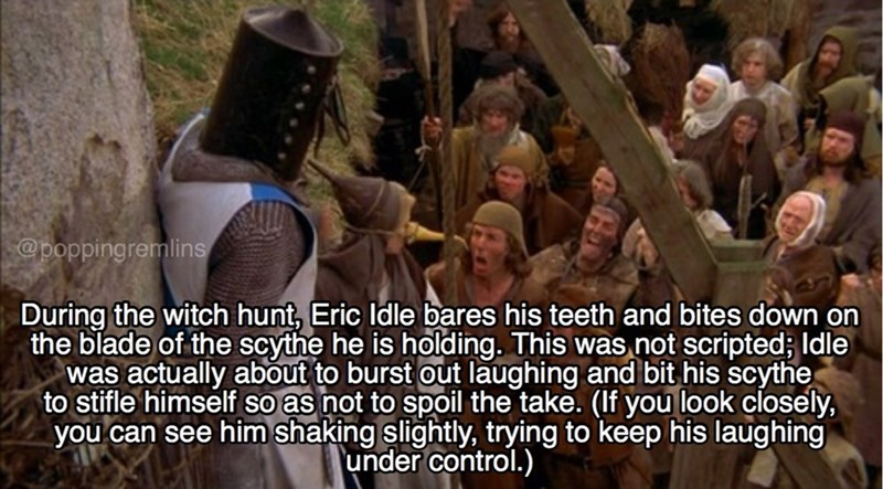 monty python - Photo caption - @poppingremlins During the witch hunt, Eric Idle bares his teeth and bites down on the blade of the scythe he is holding. This was not scripted; Idle was actually about to burst out laughing and bit his scythe to stifle himself so as not to spoil the take. (If you look closely, you can see him shaking slightly, trying to keep his laughing under control.)