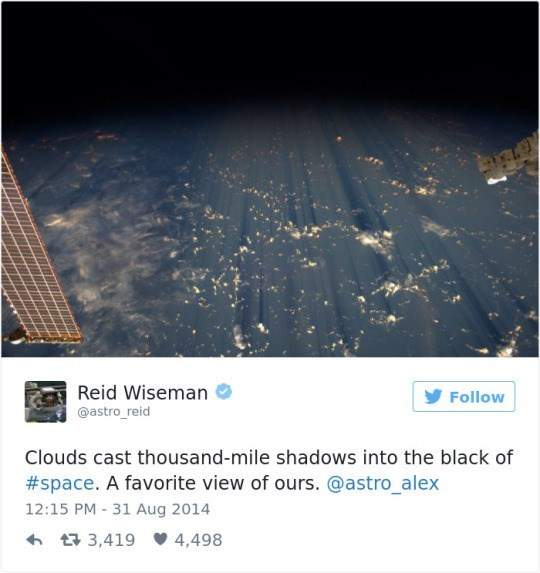 Text - Reid Wiseman Follow @astro_reid Clouds cast thousand-mile shadows into the black of #space. A favorite view of ours. @astro_alex 12:15 PM 31 Aug 2014 t3,419 4,498
