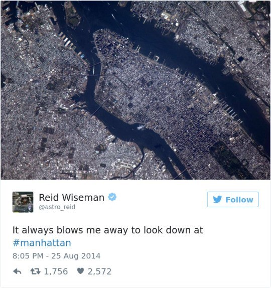 Text - Reid Wiseman @astro_reid Follow It always blows me away to look down at #manhattan 8:05 PM -25 Aug 2014 1,756 2,572