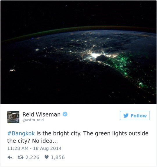 Astronomical object - Reid Wiseman Follow @astro_reid #Bangkok is the bright city. The green lights outside the city? No idea... 11:28 AM 18 Aug 2014 2,226 1,856