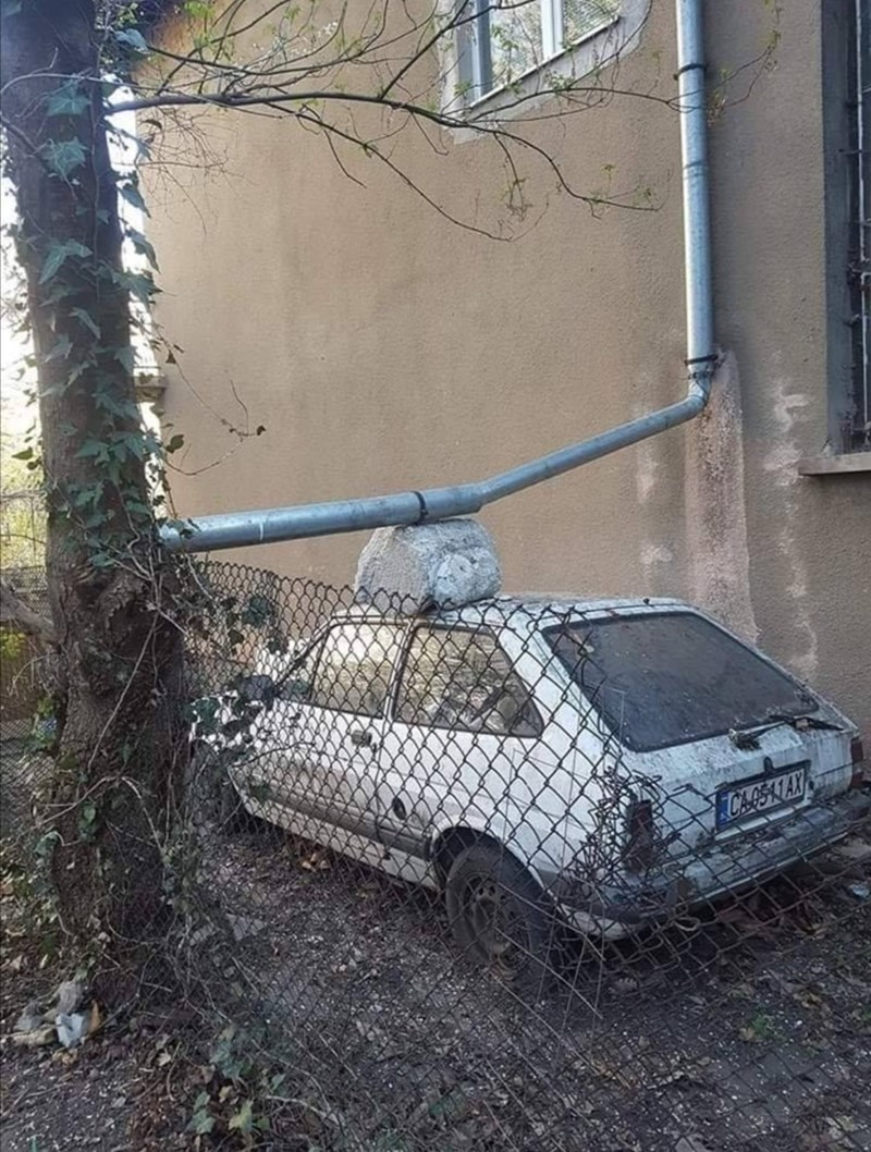 a car supports a drainage pipe