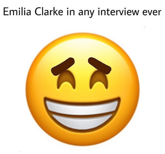 Funny meme of an emoji used to describe Emilia Clarke's face when she's being interviewed.