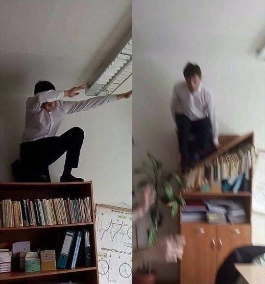 A kid dabs on a bookshelf and falls.