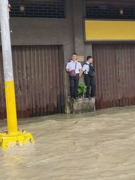 Two guys stand above a flood.