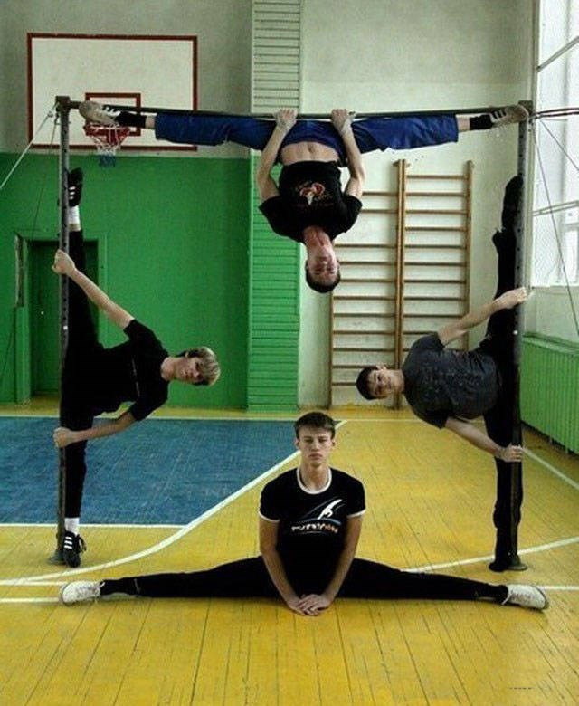 acrobats do splits in a square