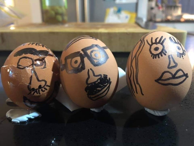 Eggs with goofy faces on drawn on them, one seems to be cracked