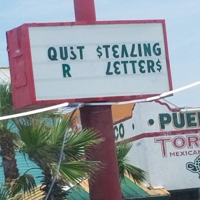 Street sign - QUST STELING R PUE CO TOR MEXICA