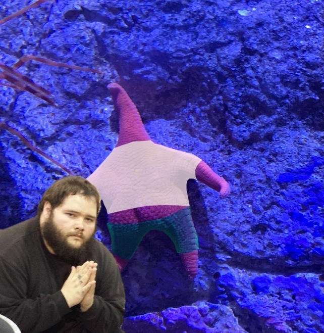 thicc starfish wearing white shirt and blue pants and man praying to it
