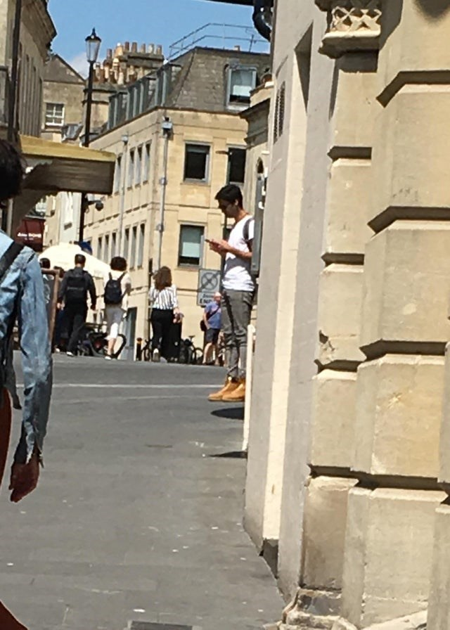 view of street and man who looks like he is floating