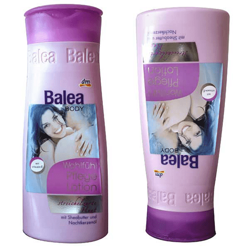 two purple shampoo bottles