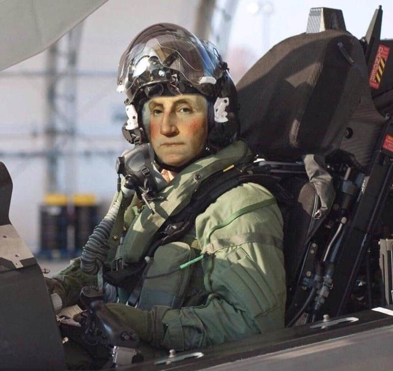 george washington sitting in a fighter plane as a pilot