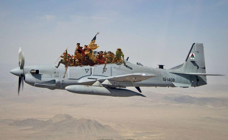 a grey military airplane flying over desert with old fashioned soldiers sitting in the plane