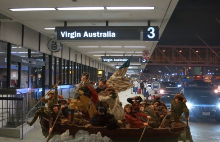 soldiers in a boat from the 'washington crosses the delaware' painting photoshopped into terminal 3 Virgin Australia airport