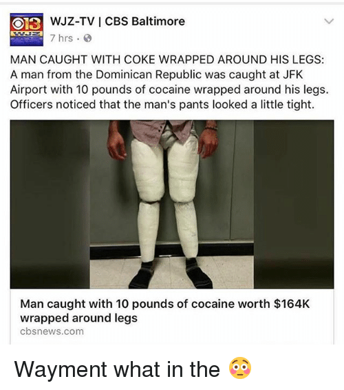 a man's legs with white bags of cocaine wrapped around his legs with white tape