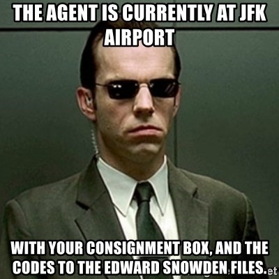 agent smith from the matrix looking serious and wearing dark glasses