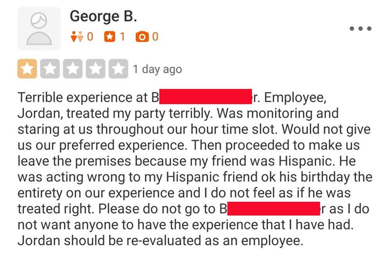 Text - Yelp review claiming that an employee at an axe-throwing facility was acting racist toward the customer