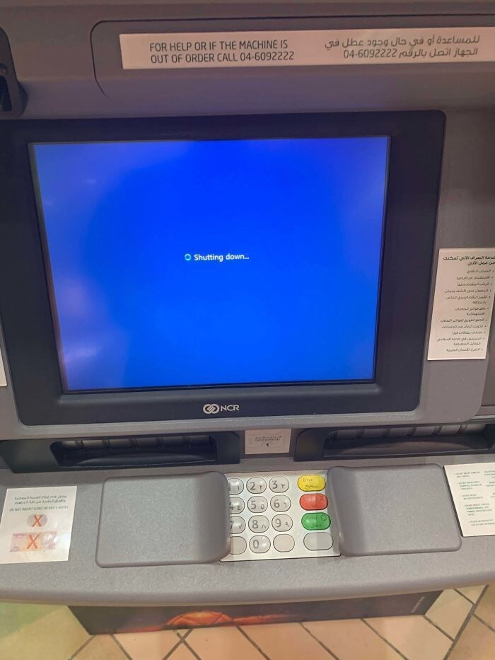 Screen - FOR HELP OR IF THE MACHINE IS OUT OF ORDER CALL 04-6092222 04-6092222ray dail je Shutting down.. cusapWaliees auARa laivoda wasiautea AueJekE NCR FX2