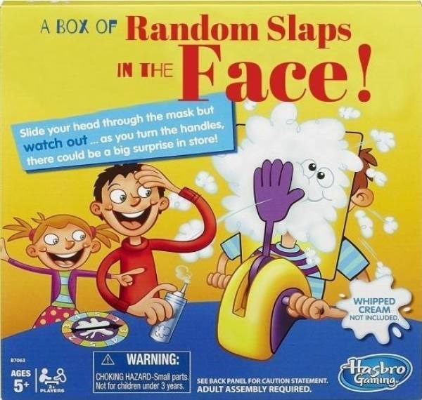 Cartoon - A BOX OF Random Slaps Face! IN THE Slide your head through the mask but watch out... .as you turn the handles, there could be a big surprise in store! WHIPPED CREAM NOT INCLUDED. A WARNING: Hasbro Gaming 87063 AGES CHOKING HAZARD-Small parts Not for children under 3 years. SEE BACK PANEL FOR CAUTION STATEMENT ADULT ASSEMBLY REQUIRED. 5* PLAYERS