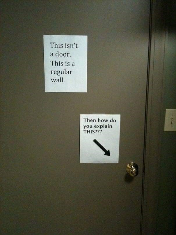 co-worker - Text - This isn't a door. This is a regular wall. Then how do you explain THIS???