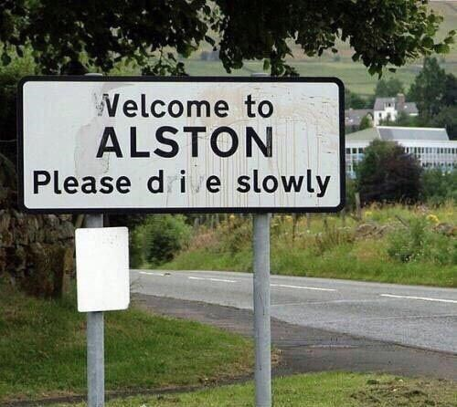 Street sign - Welcome to ALSTON Please di e slowly