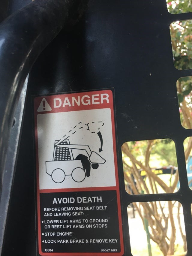 Motor vehicle - ADANGER AVOID DEATH BEFORE REMOVING SEAT BELT AND LEAVING SEAT: LOWER LIFT ARMS TO GROUND OR REST LIFT ARMS ON STOPS STOP ENGINE LOCK PARK BRAKE &REMOVE KEY U604 86521683