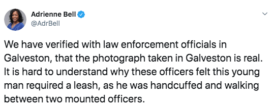 crime - Text - Adrienne Bell @AdrBell We have verified with law enforcement officials in Galveston, that the photograph taken in Galveston is real. It is hard to understand why these officers felt this young man required a leash, as he was handcuffed and walking between two mounted officers.