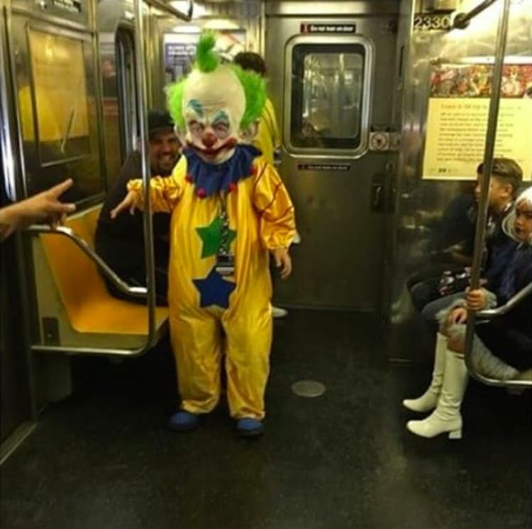 Funny photo of a guy dressed in a clown suit