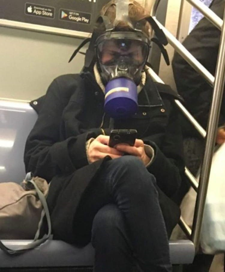 Funny picture of someone wearing a gas mask on the subway
