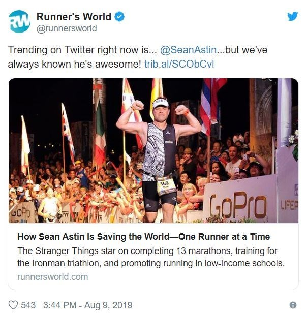 Text - Runner's World RW @runnersworld Trending on Twitter right now is... @SeanAstin...but we've always known he's awesome! trib.al/SCObCvl 143 COPro LIFER GOPh How Sean Astin Is Saving the World-One Runner at a Time The Stranger Things star on completing 13 marathons, training for the Ironman triathlon, and promoting running in low-income schools. runnersworld.com 543 3:44 PM - Aug 9, 2019