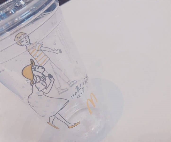 Drawing - Ve - mcdonalds cup at an angle makes it look like girl is kissing boys butt