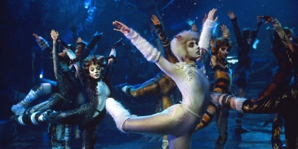 Still shot of actors from the cats musical dancing in a group