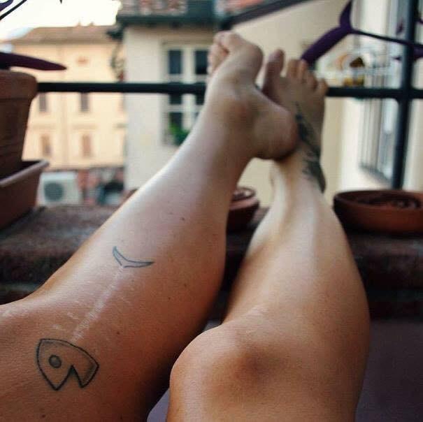 scar tattoo - Human leg