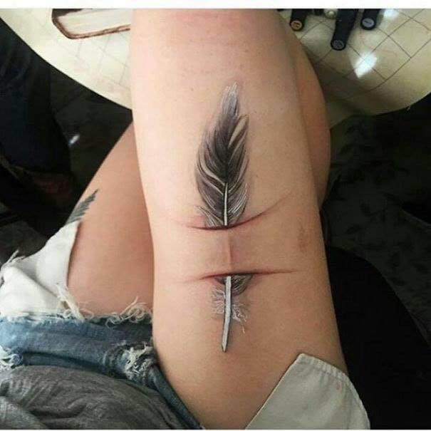 scar tattoo - Feather