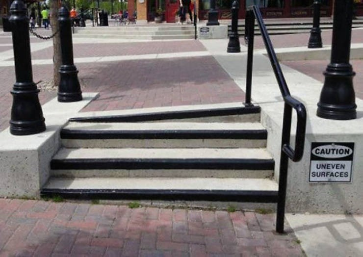 design fail - Sidewalk - CAUTION UNEVEN SURFACES